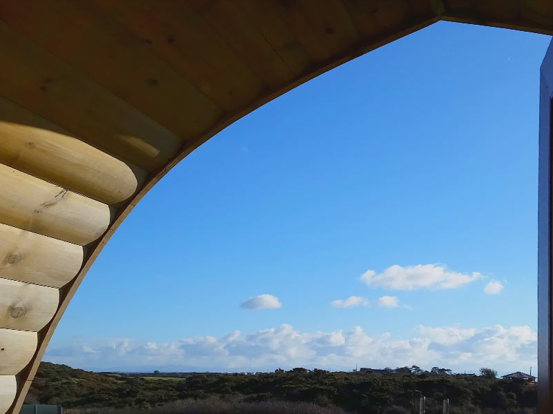 View of blue sky from Glamping Pod porch