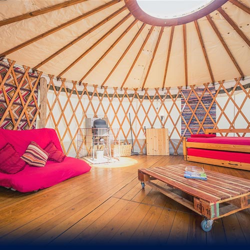 Internal photo of yurt with wooden funiture