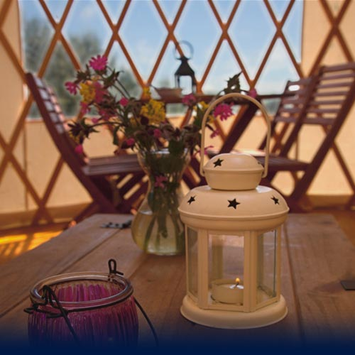 Internal of a yurt at dusk with candle burning.jpg